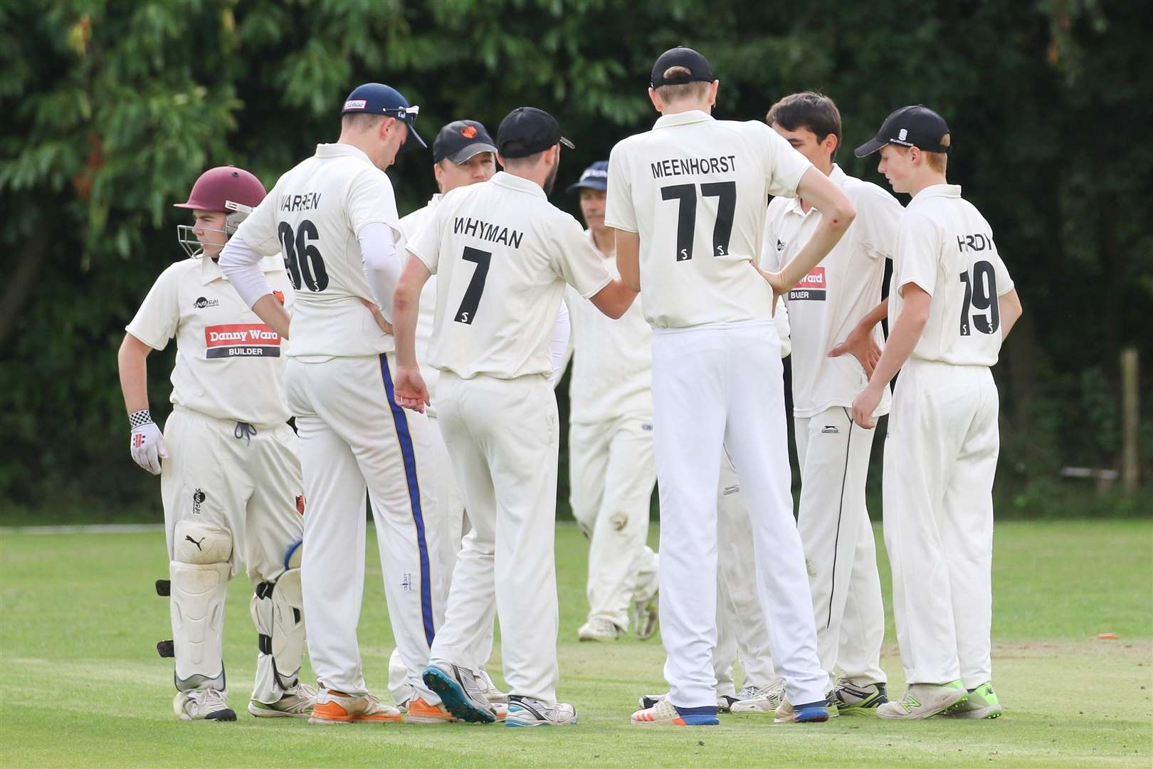 KEY WICKET: Diss Cricket Club discuss their next move after capturing the key Old Buckenham wicket of Ben Shearing, as they took six wins from seven to end their season