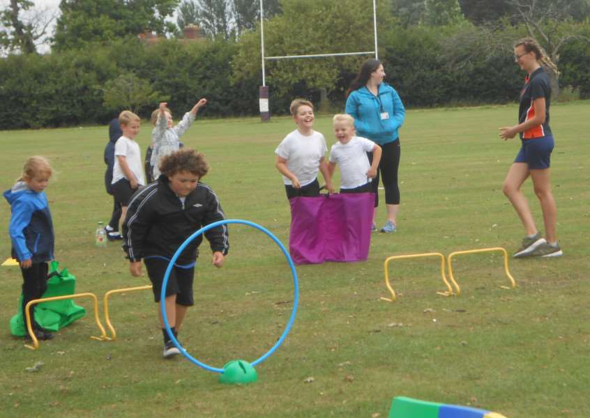 More than 300 children enjoy a picnic and activities at a sports day at Diss High School.