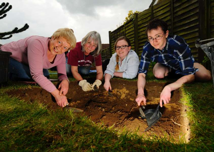 Tasburgh, Norfolk. Archaeological test pits are being dug in gardens around Tasburgh as part of Imagined Land, a two-year archaeology project looking into the ancient history of the village. pictured from left Jill Casson, Jenny Press, Samantha Best and Alex Bjorkegren digging a test pit in the garden of Claire and Nigel Best.''Picture: MARK BULLIMORE