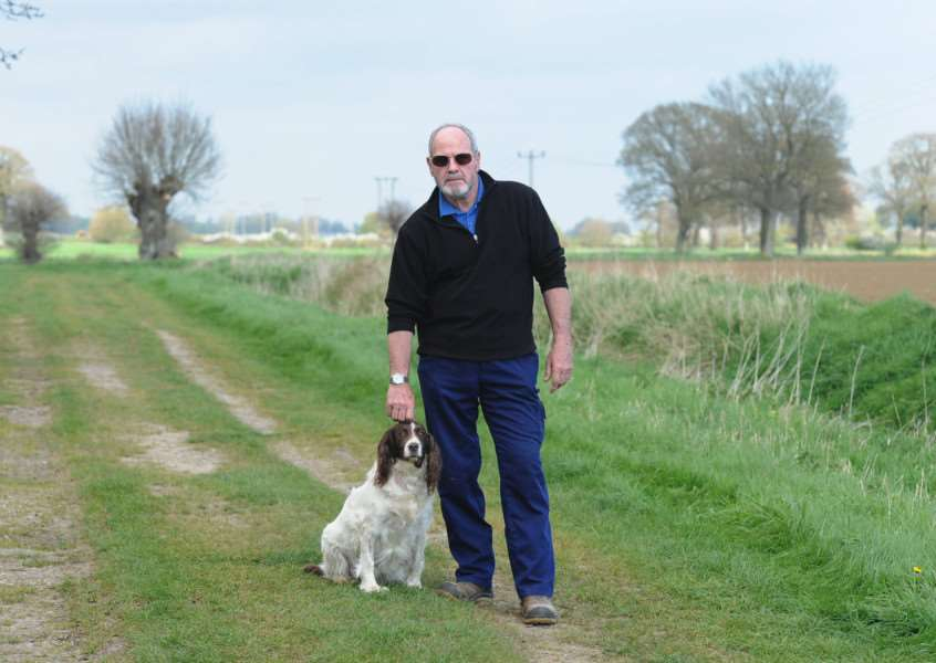 John Atkins and his 12-year-old springer spaniel, Izzy