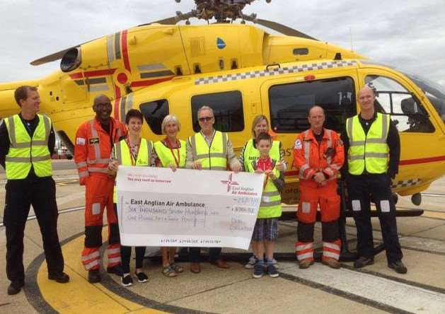 The helicopter crew of the East Anglian Air Ambulance, along with four diers who helped raised funds. Diss Cyclathon has raised �6,700 for the air ambulance. Submitted photo.