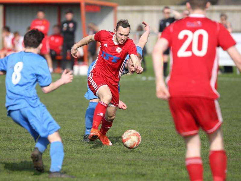 WORKING HARD: Haverhill Rovers' Joe Bennett fights through midfield in a team performance that led to a 2-1 home victory. Picture: Richard Marsham