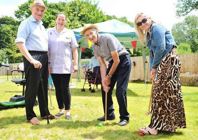 Residents Staff and guests of Hartismere Place care home enjoy the sunshine at the Care uk open day Residents Ivan and Alfie with Guest Emma Tillson and staff member Loraine precey