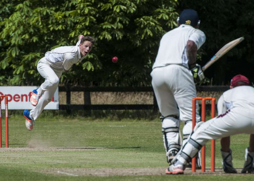 STEAMING IN: Matt Hendire bowls for Old Buckenham II during Saturday's home defeat to Martham