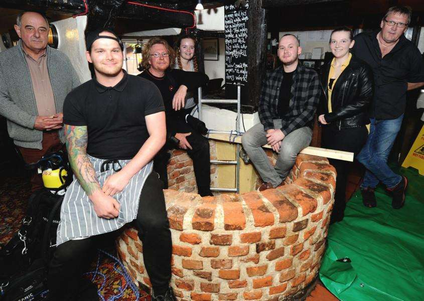The Four Horseshoes Pub sent a diver down their well to collect 10+ years of coins, which they are to give to charities''Pictured: Staff and Dive Line who were doing down the well'''PICTURE: Mecha Morton