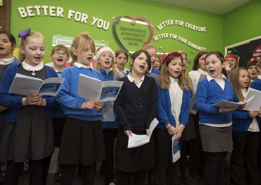 Young carollers from Harleston Primary School have brought Christmas joy to East of England Co-op customers at the Harleston branch. Picture: Anglia Picture Agency.