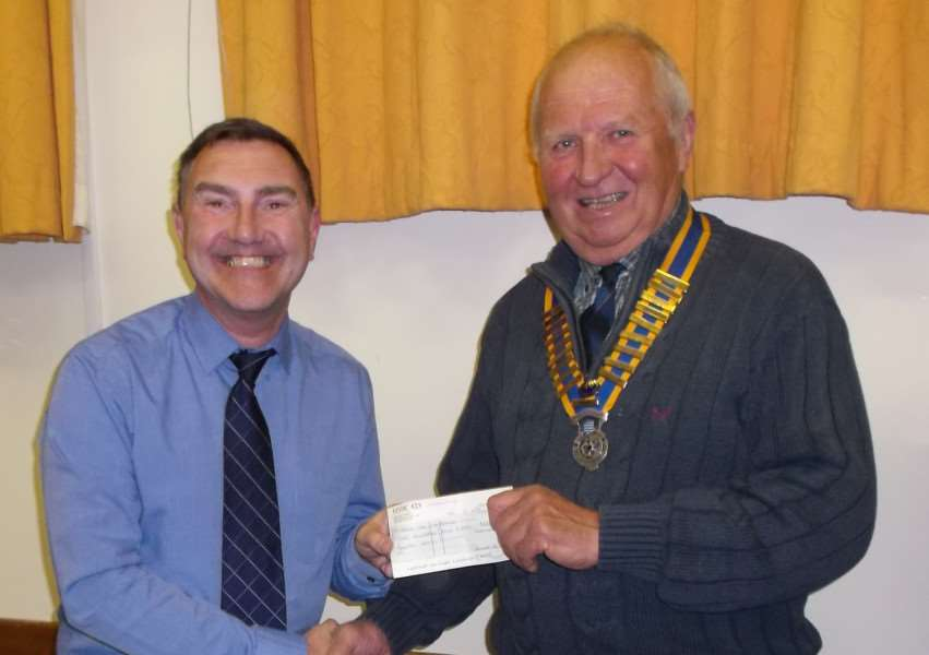 Dick Mitchell (right), of Diss Rotary Club, presents a cheque to Michael Danm, musical director of Discord. ANL-160305-165553001