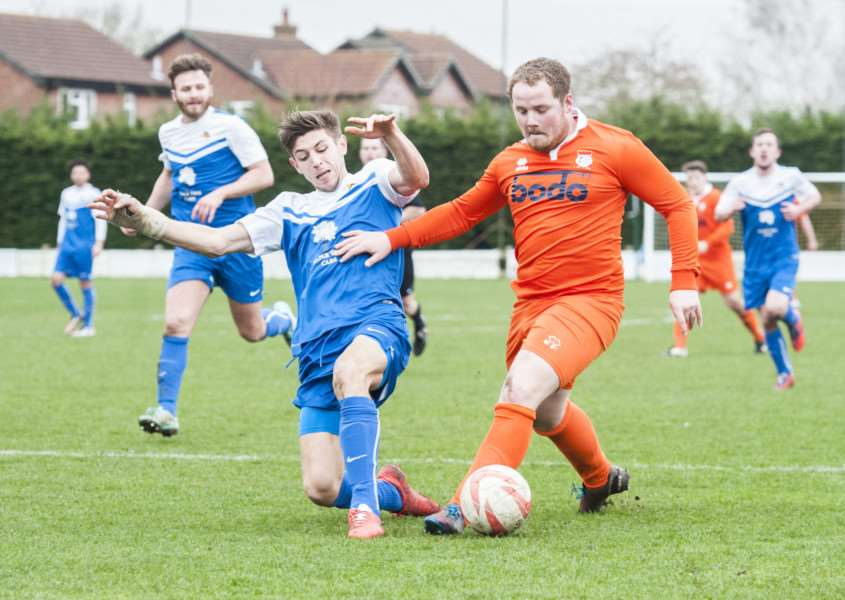 UNDER ATTACK: Adam Burroughs receives close attention during Diss Town's 1-1 draw against Wivenhoe Town