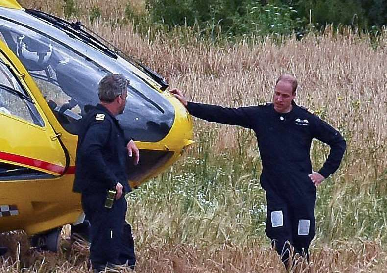 Prince William arrives in his helicopter at Gislingham