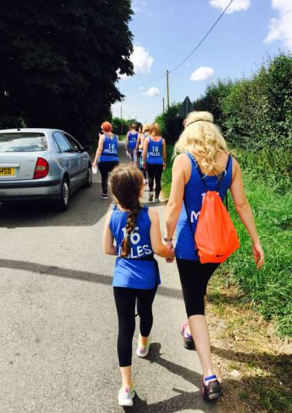 Employees of Diss salon Crackers and Chaps walked 16 miles from Attleborough, raising money for an unwell toddler. ANL-150818-121607001