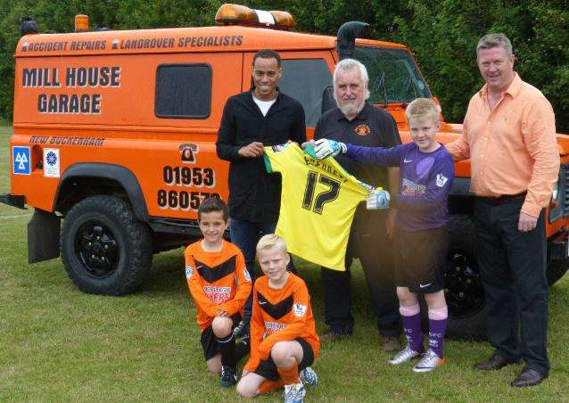SPECIAL GUEST: Norwich City midfielder Elliott Bennett (left) with New Buckenham FC's main sponsor Clive Rush of Mill House Garage (left of centre), chairman Andy Nicholls (right) and Under-9 players (from left) Aston Jaggard, Kieran Lond-Caulk and Max Nicholls.