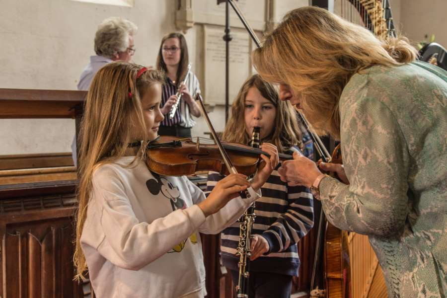 Rosemary Warren-Green teaches youngsters at the music camp day at St. Andrew's Church, Fersfield on August 21. Picture: Krys Wakefield.