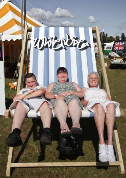 Three generations of the Connor family chill out in a giant deckchair ANL-160808-084124005