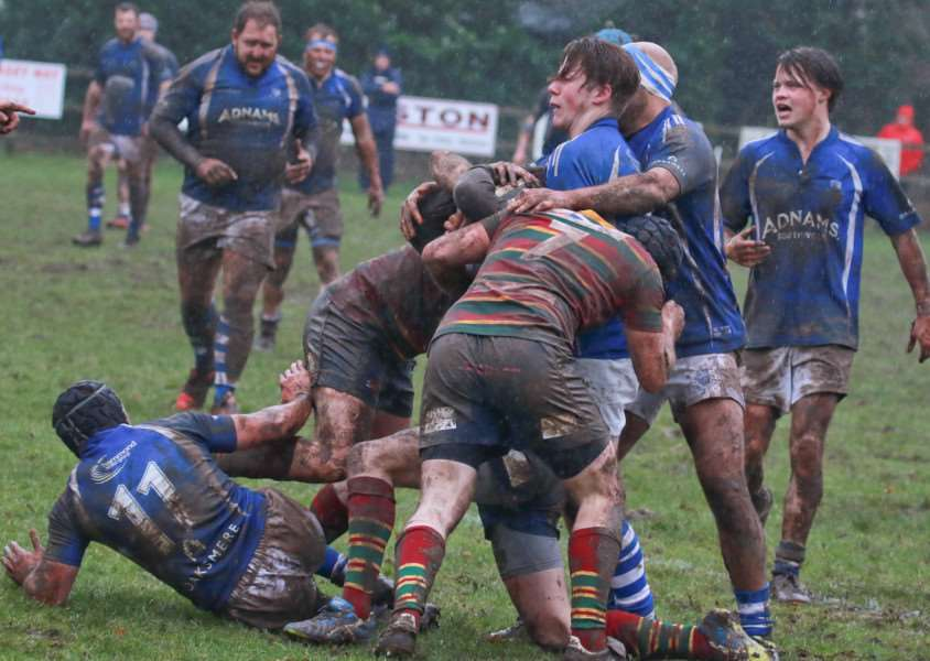 TOUGH CONDITIONS: The conditions played a part in the game as it turned into a mudbath (Pictures: Gary Donnison)