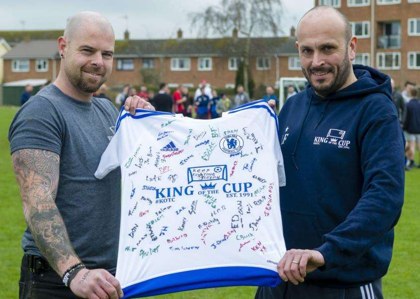 Bobby Kilkenny and Lee Farrell holding a sign shirt of all the players in the tournament.' 'Picture: Mark Bullimore Photography