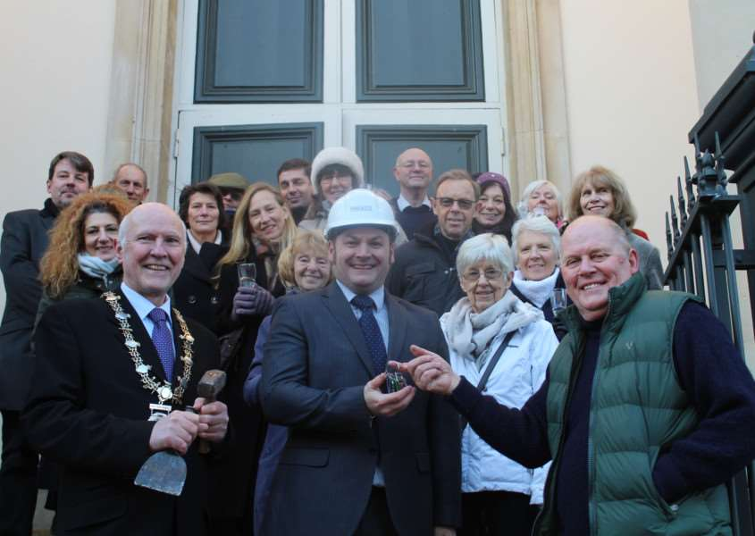 The keys of the iconic Diss Corn Hall are handed over to contrators Pentaco to begin work. ANL-160118-161035001