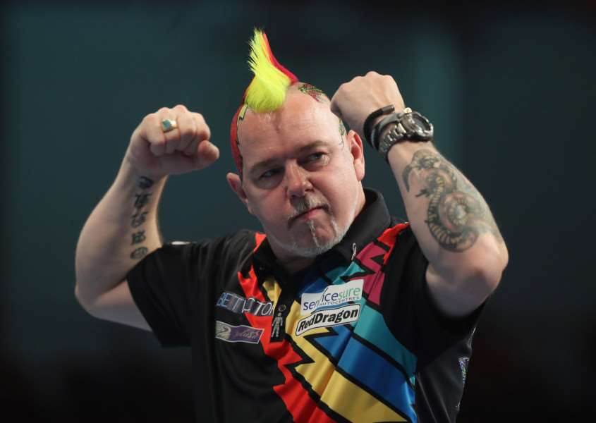 MARCHING ON: Peter Wright won comfortably against Cristo Reyes. Picture: Lawrence Lustig/PDC