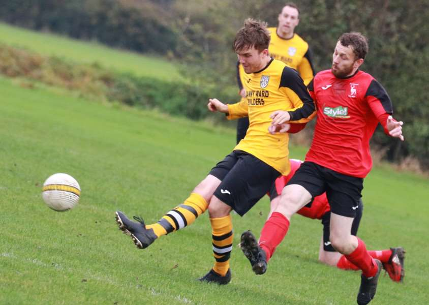 CLOSE SHAVE: Ashley Baxter (left) came close to scoring for Scole during their 3-0 defeat away at Thetford Town