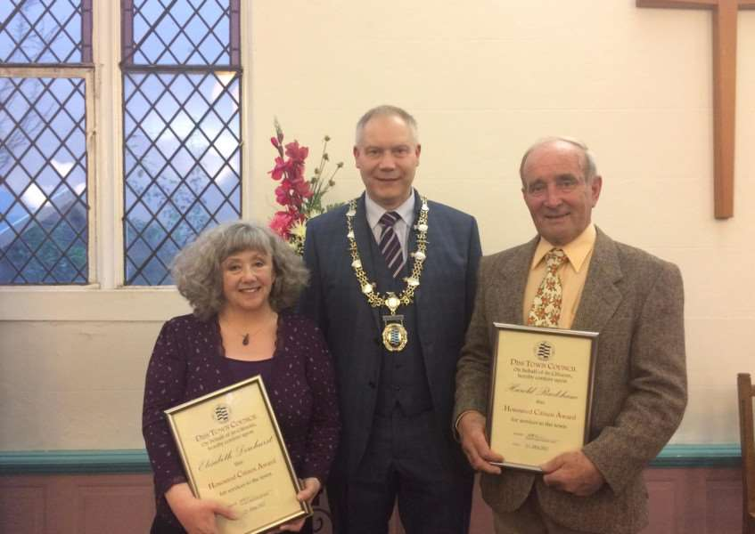 Beth Dewhurst (left) and Harold Rackham (right) are presented the Diss Honoured Citizen Award by town mayor Mike Bardwell. Photo: Diss Town Council.