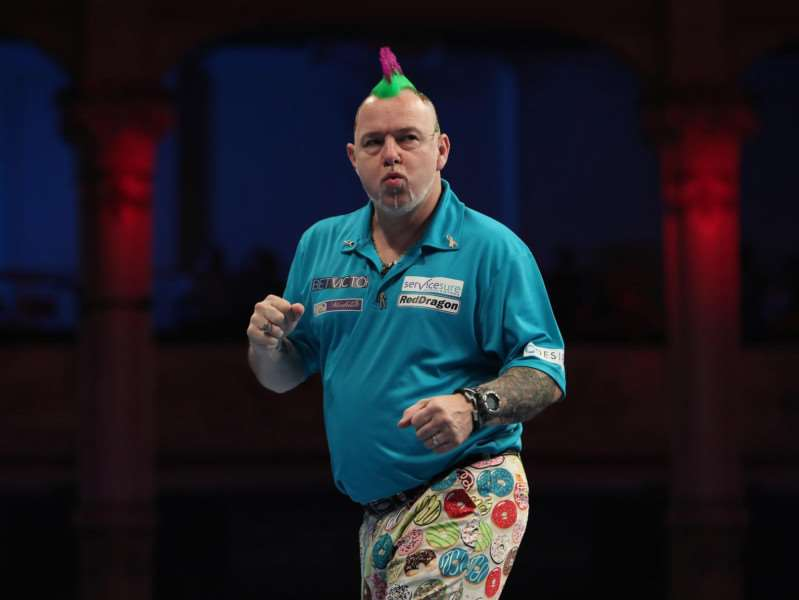 Peter Wright was left celebrating at the end of his quarter-final Picture: Lawrence Lustig/PDC