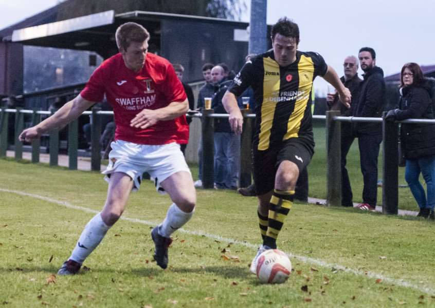 HOME LOSS: Jack Severy attempts to beat his marker during Debenham's defeat to Swaffham on Saturday