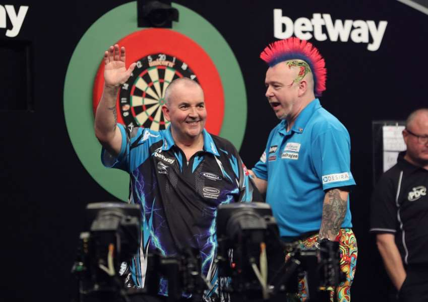 Earlier in the night Wright got the better of Phil Taylor. Picture: Lawrence Lustig