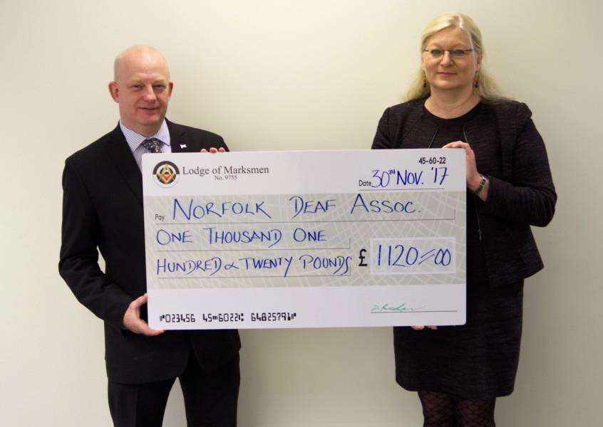 Nigel Hood from the Lodge of Marksmen Harleston presents a cheque to Aliona Derrett, CEO Norfolk Deaf Association. Submitted picture.