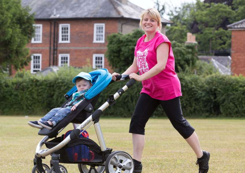 Lisa Hartgrove and son Calum getting ready to take on the Race for Life in King's Lynn later this month. ANL-150716-120032001
