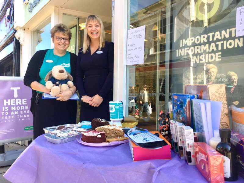 Left to right,fundraiser Sarah Reader with store manager Emily Smyth at Specsavers store in Mere Street, Diss. Picture: Andrew Martin