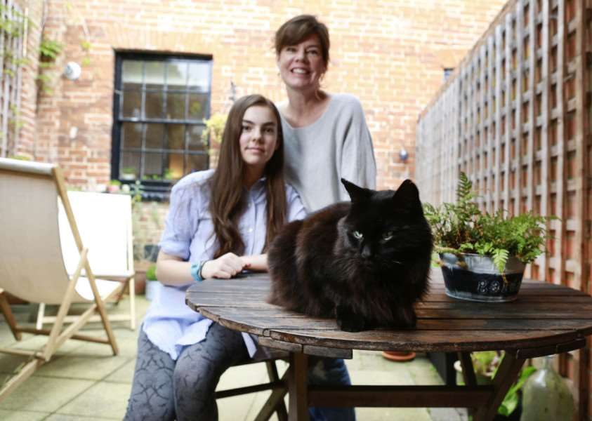 Juliet and Nell Talbot, aged 14, from with their pet cat Percy who has been nominated in the Most Caring Cat category in this years' National Cat Awards. PHOTO: Ben Lister/PA Wire.