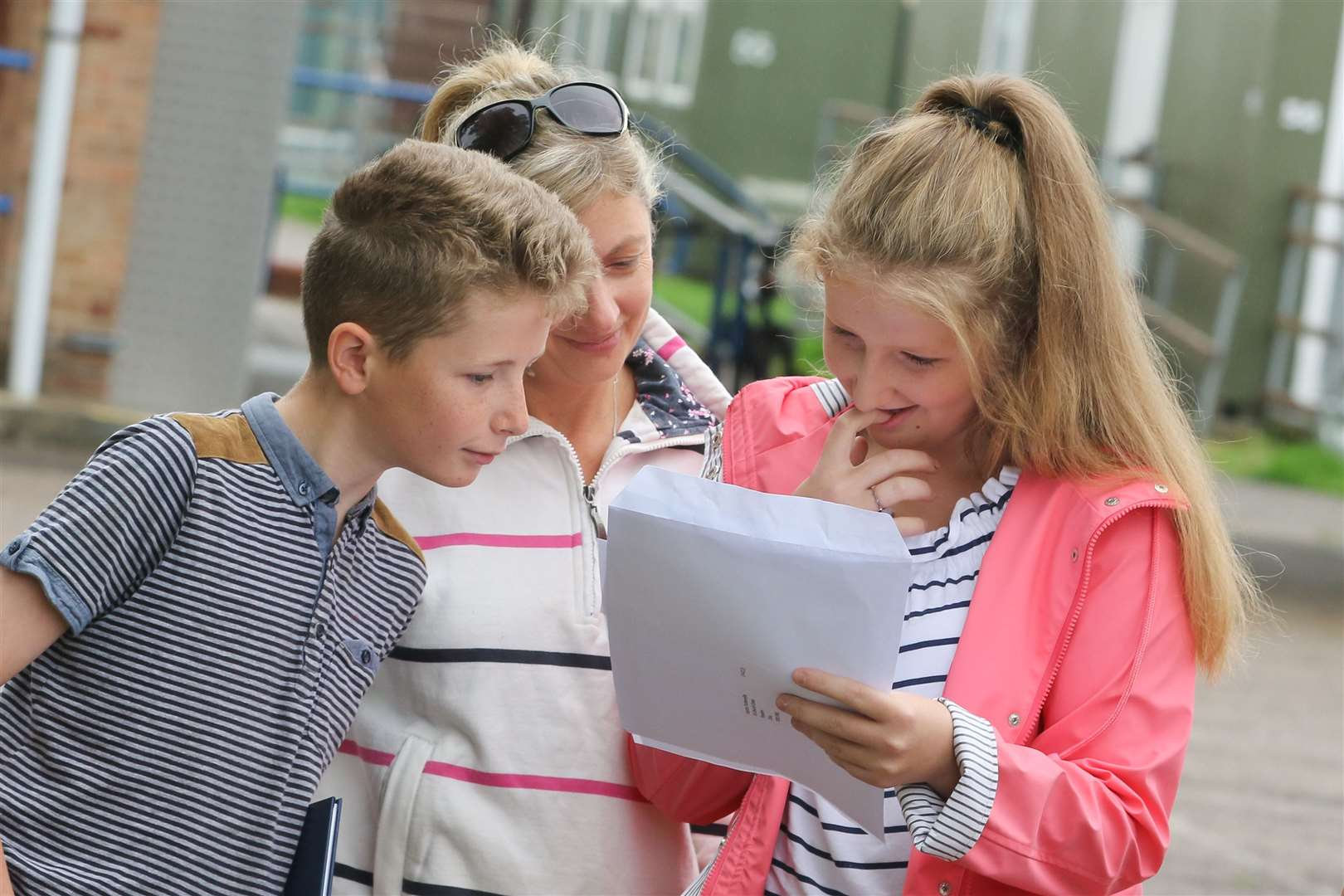 A student checks her results with her family at last year's GCSE results day.