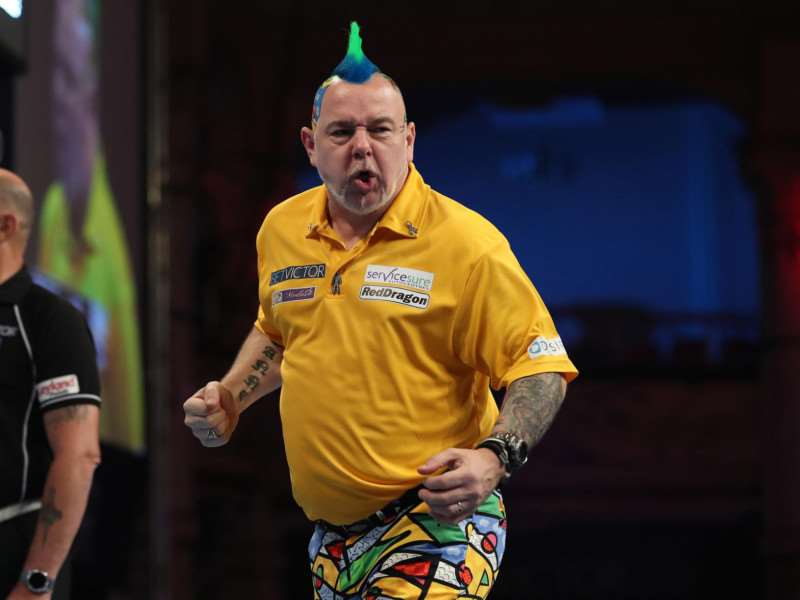 TRIUMPHANT: Peter Wright celebrates during last night's semi-final victory over Daryl Gurney Picture: Lawrence Lustig/PDC