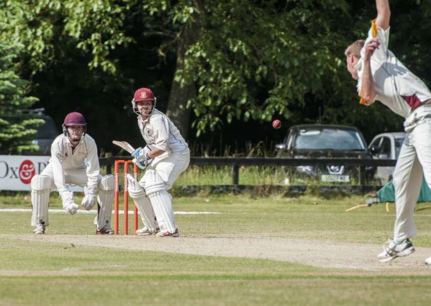 DERBY DAY: James Gooderham bowls a delivery to Old Bucks' Matthew Bint