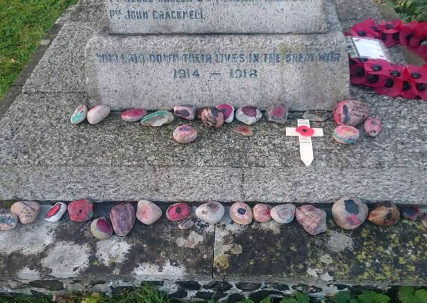 Penny Killian Anderson, with friends and family, placed more than 300 colourfully decorated stones in Diss and other nearby war memorials. Submitted picture.