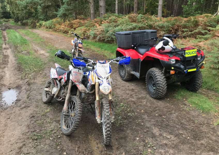 A police quad bike with some illegal motorbikes in Thetford Forest