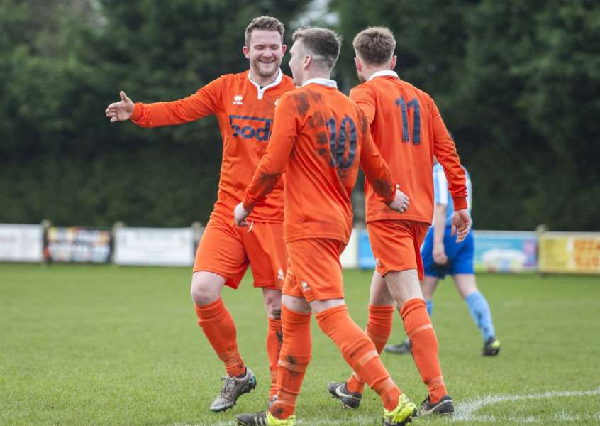 CELEBRATION TIME: Diss Town players celebrate one of their nine-goal haul against Braintree Town Reserves