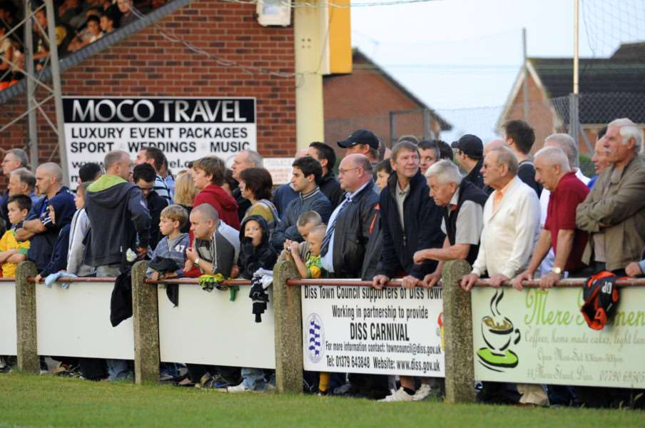 Tangerines supporters watch the football action from Diss Town FC