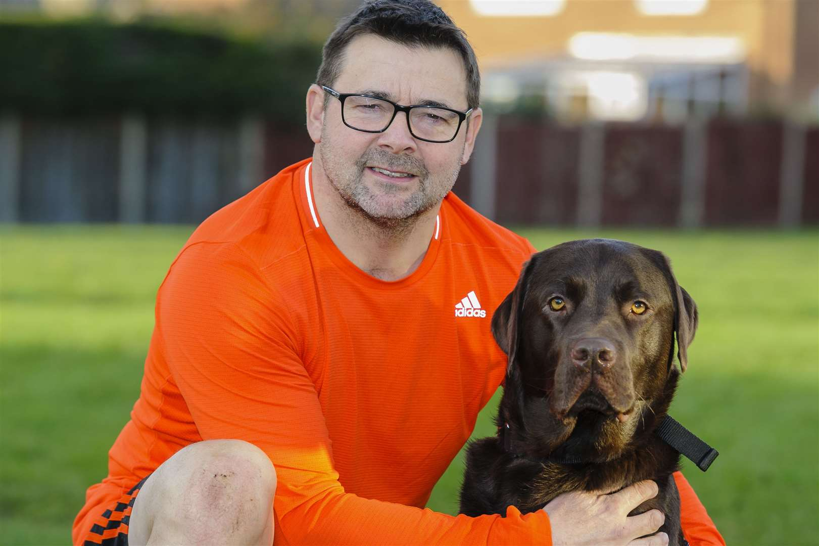 Dennis Harris of Diss took part in the London Marathon for two-year-old Jack Wright who has a rare genetic disorder. He's pictured with his dog Douglas. Picture by Mark Bullimore Photography.