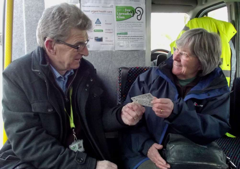 John, volunteer on the Hearing Support Service Mobile Clinic with service user Mary.
