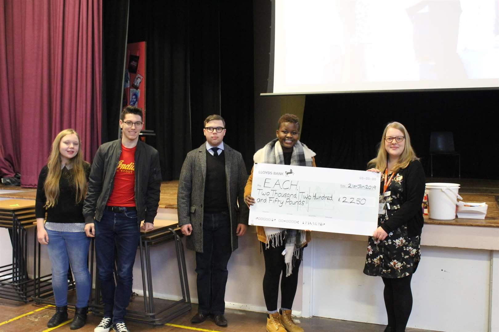 Pupils present their cheque to Each