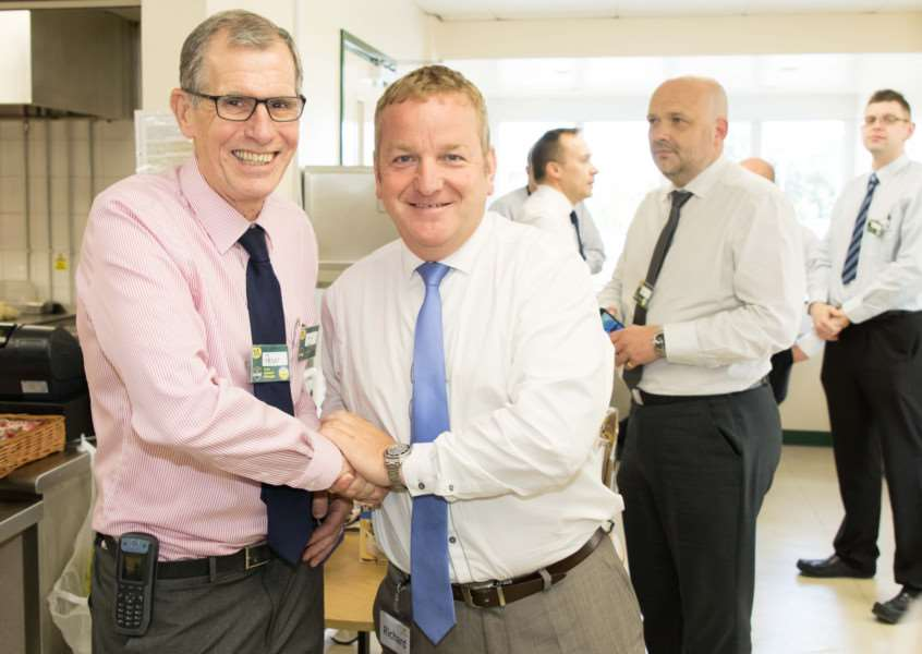 Retiring Diss Morrisons manager Peter Morley (left) with Richard Gray, the supermarket's Regional Managing Director.