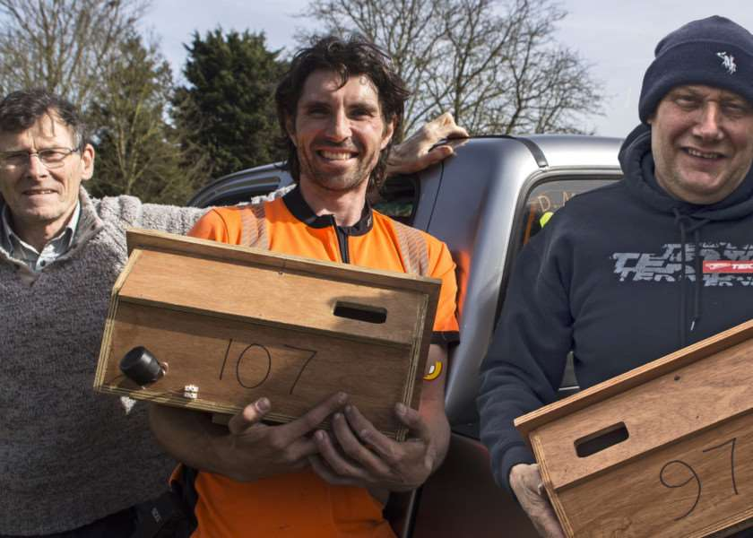 Peter Metcalf, of Harleston's Future, tree surgeon Daniel Meadows and builder Paul Nelson help install the new swift nesting boxes around Harleston.