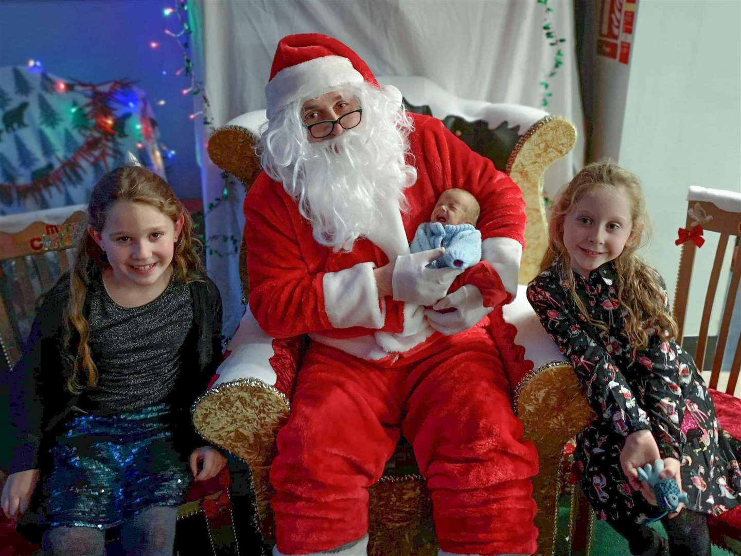 Cadence, Sienna and Jesse with Santa Claus.