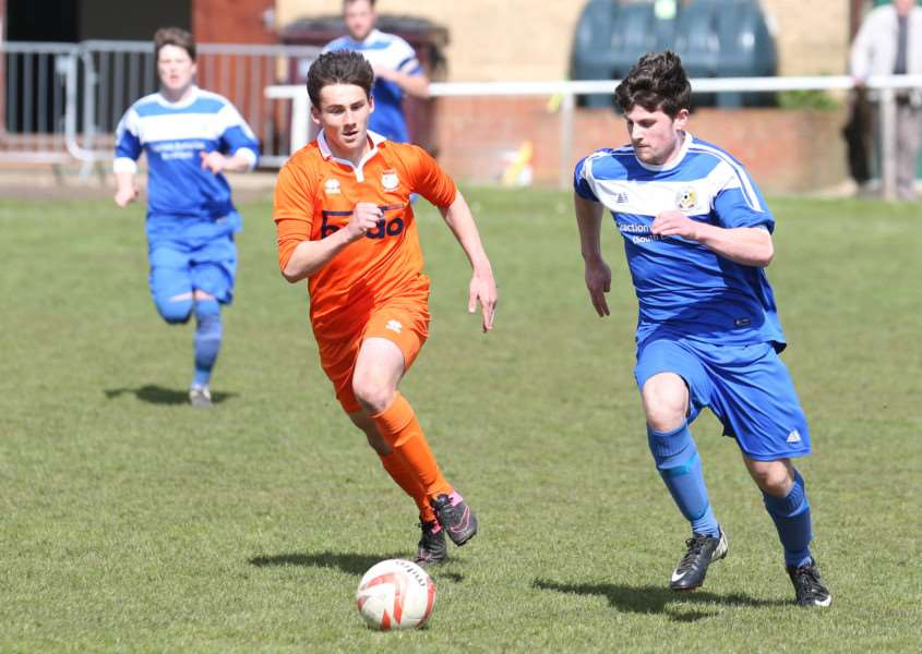 ON THE CHASE: Ben Fowkes (left) looks to win the ball back during Diss Town's 3-1 win over Cornard United