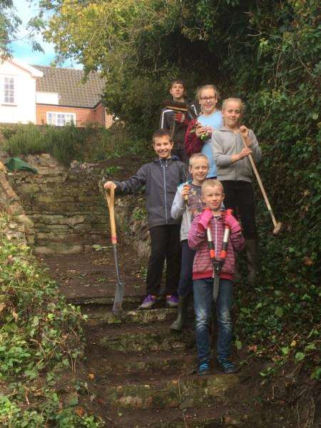 Young volunteers at the proposed site of the community wildlife garden in Diss. ANL-161223-162450001