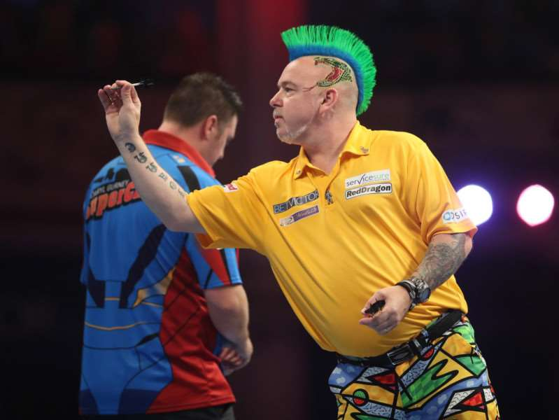 IN THE GROVE: Peter Wright in action against Daryl Gurney Picture: Lawrence Lustig/PDC