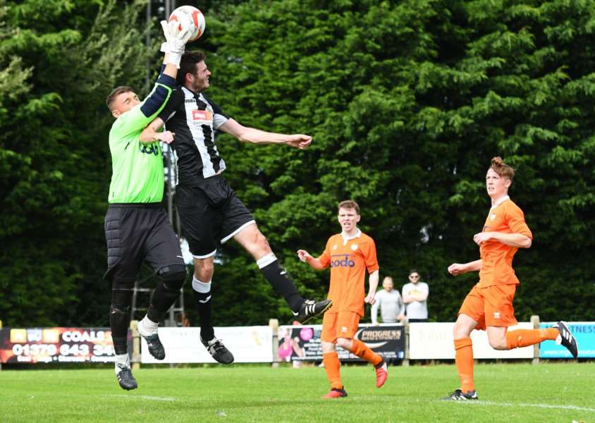 KEEPER'S BALL: Lewis Riches races off his line to thwart a Halstead attack