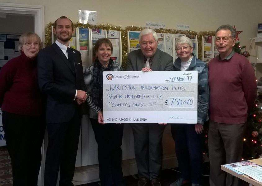 Andrew Klausner, The Lodge of Marksman's charity steward, presented a cheque for �750 to staff and volunteers of Harleston Information Plus. Submitted picture.