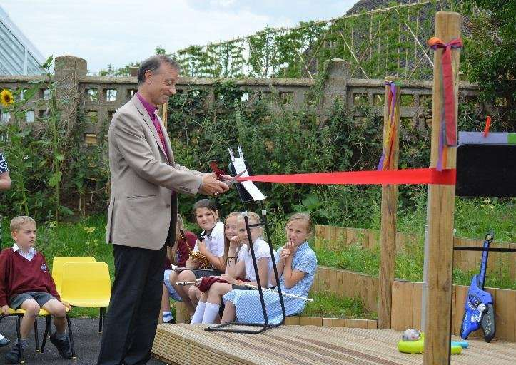 The grand opening of a new outside play area by Reverend Dr Mike Harrison at Sir Robert Hitcham CEVAP School in Debenham.