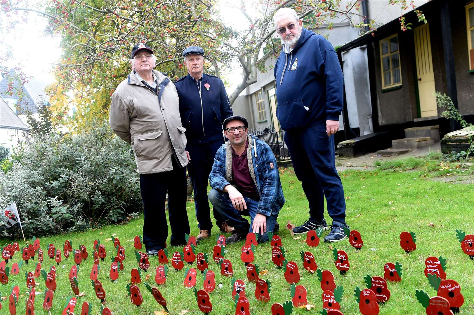 Jim Bidwell, Ralph Boone, Andrew Rackham and Robert Rogers at the poppy display at St Mary's Church. Picture by Mecha Morton.